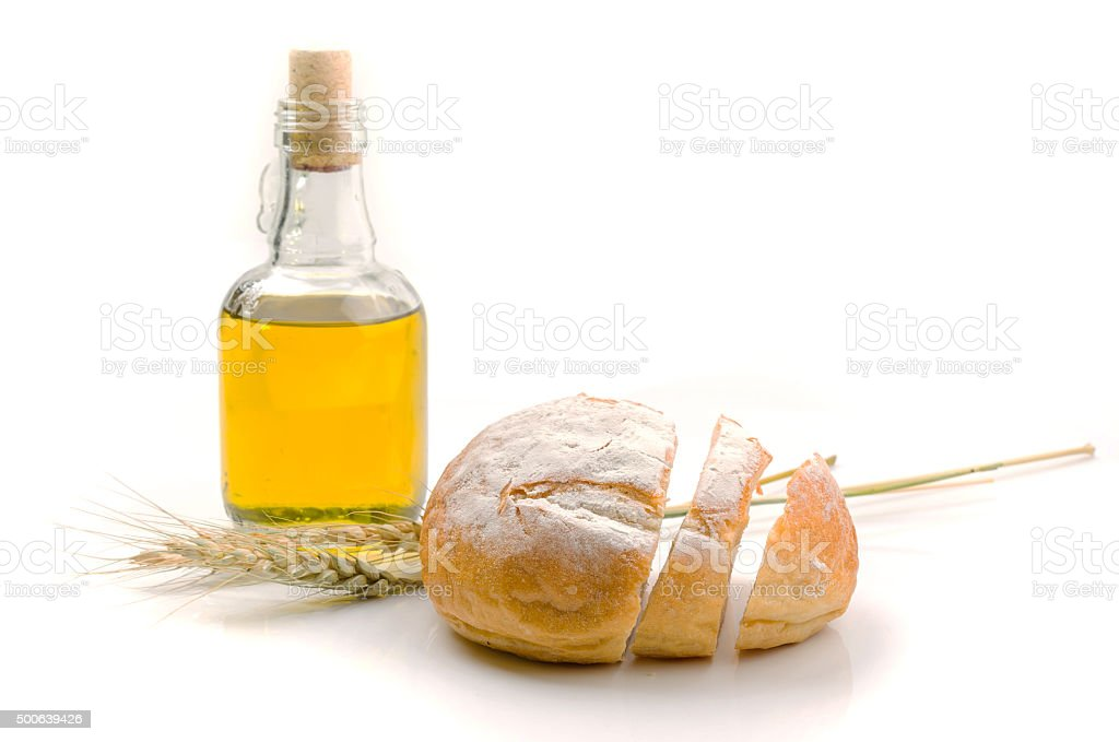 fresh bread and wheat on white stock photo