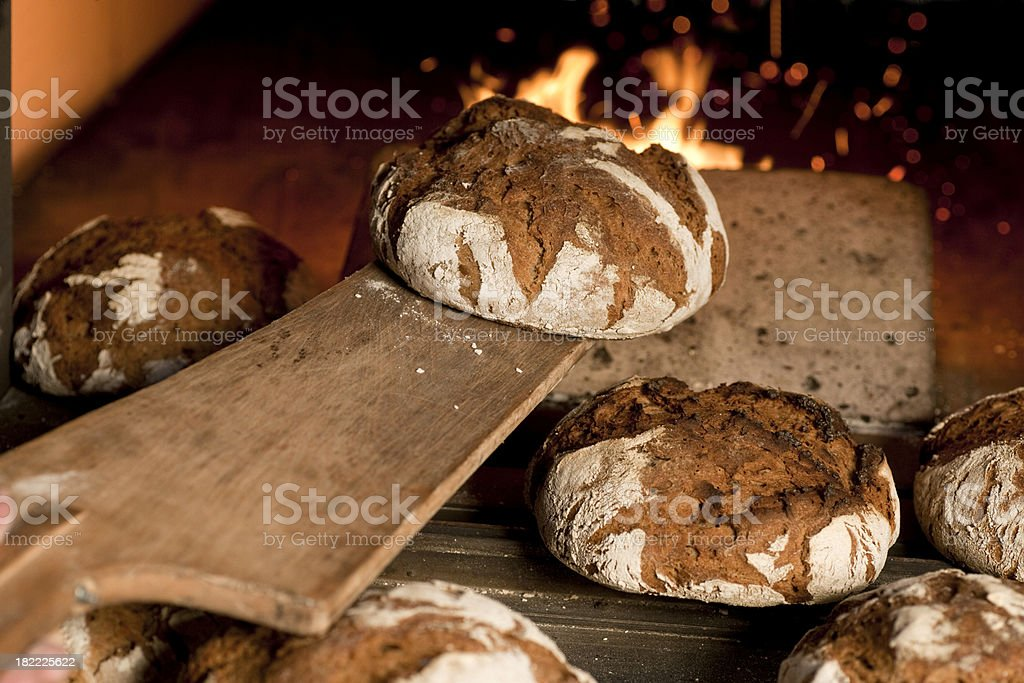 Fresh bread in oven stock photo