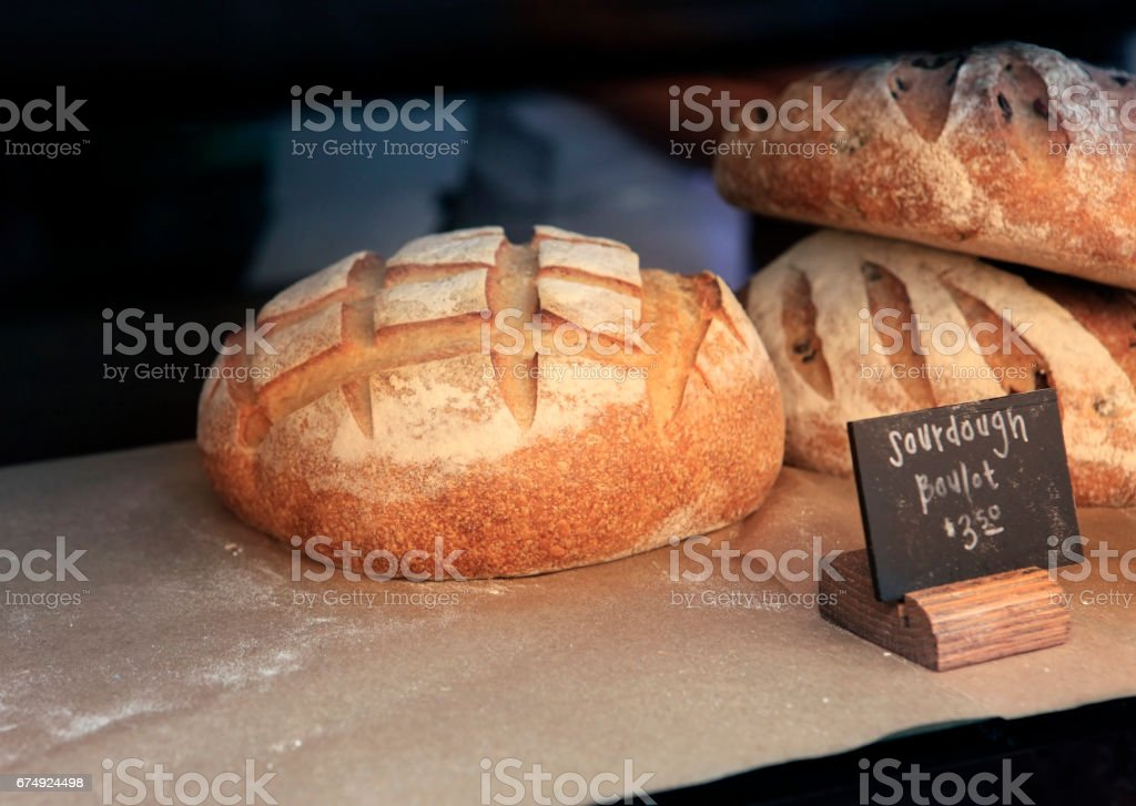 fresh bread in the shop window market royalty-free stock photo