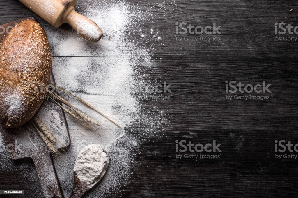Fresh bread on a wooden background stock photo