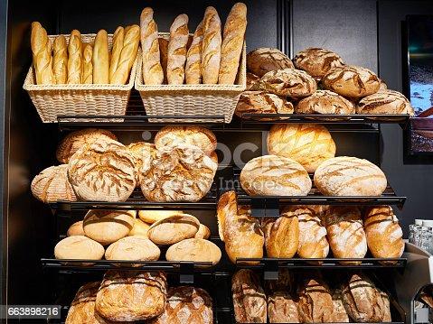 istock Fresh bread on shelves in bakery 663898216