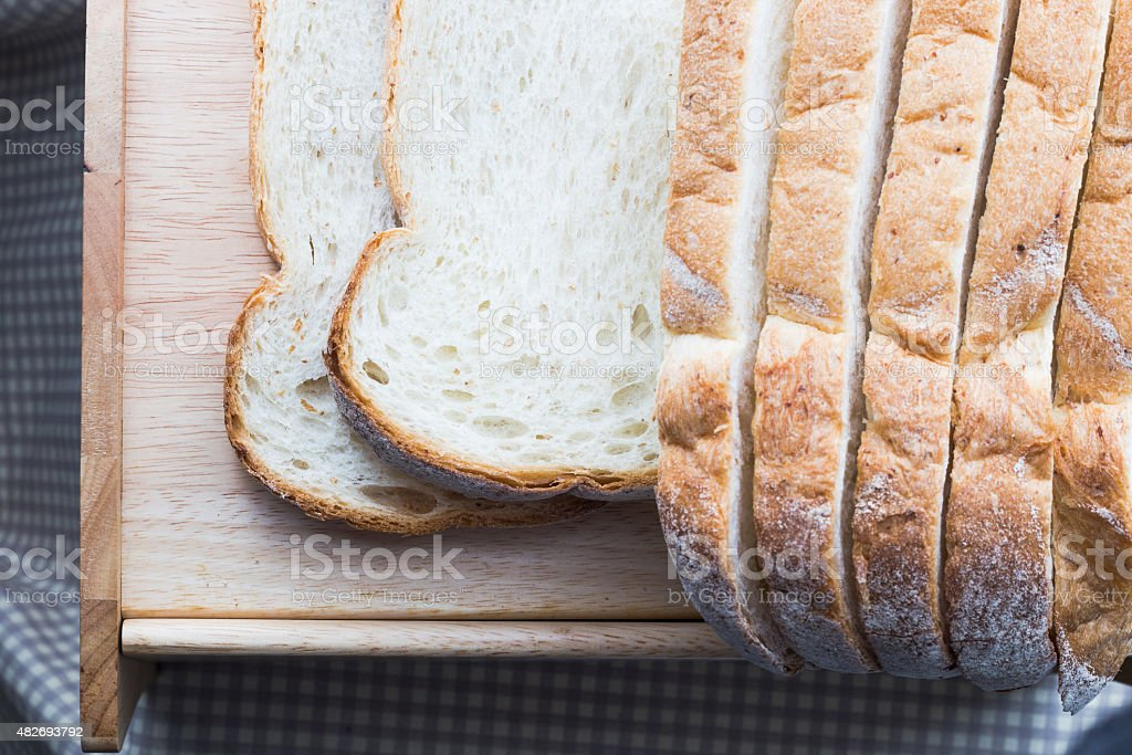 fresh bread on the wooden plate stock photo