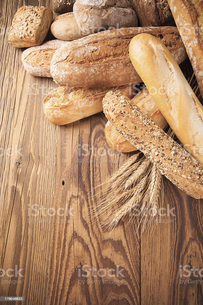 Fresh bread on wood royalty-free stock photo