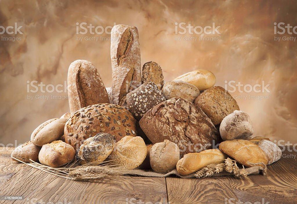 Fresh bread on wood stock photo