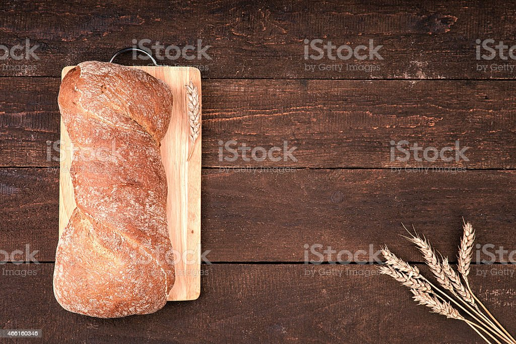 Fresh bread on wooden cutted board stock photo