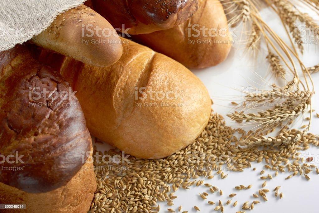 Fresh bread on wooden worktop royalty-free stock photo