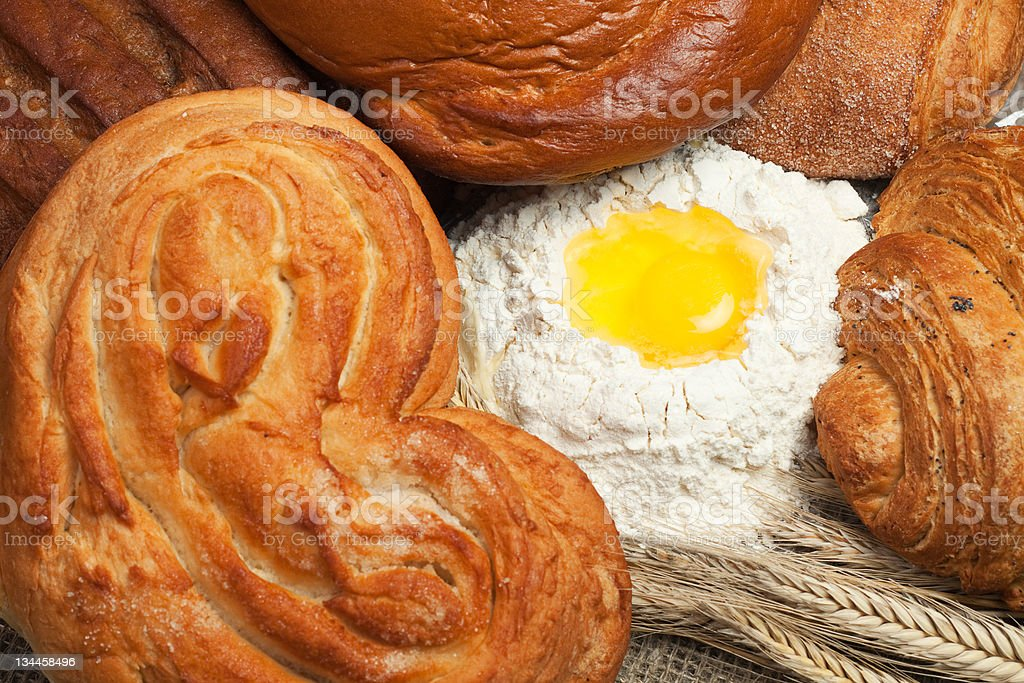 fresh bread with ears of rye and flour background royalty-free stock photo