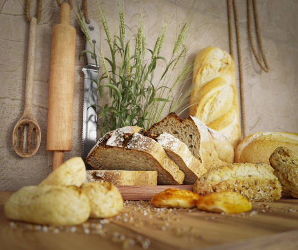 fresh bread with oat sliced on a slate cutting board photo background copy space - besteck günstig stock-fotos und bilder