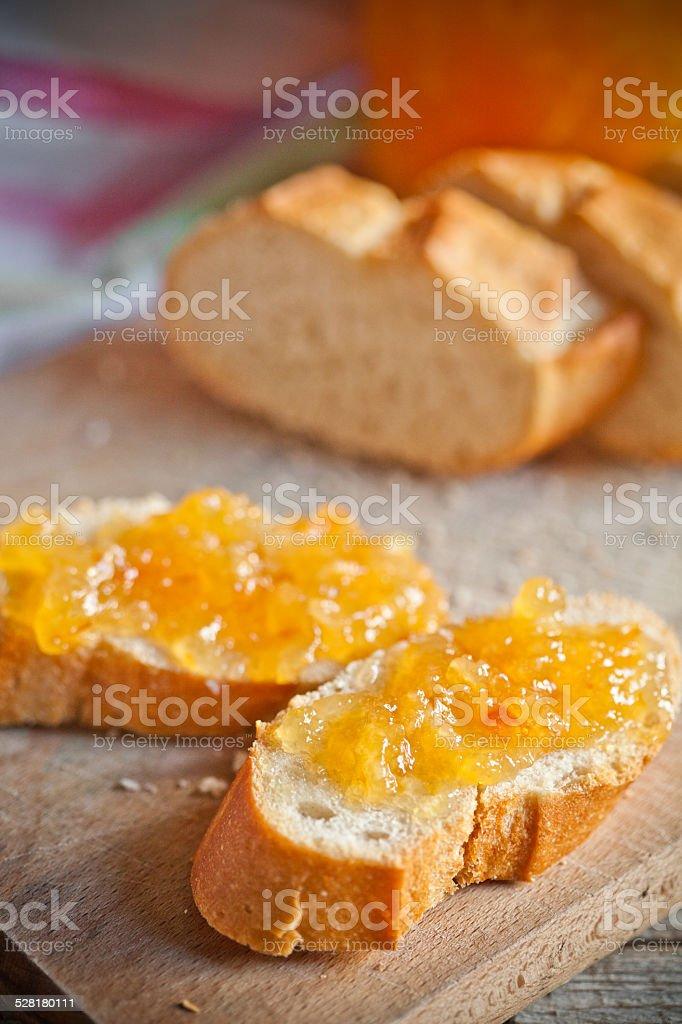 fresh bread with orange jam stock photo