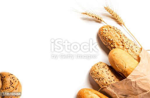 istock Fresh bread with seeds isolated on white background 1135166068