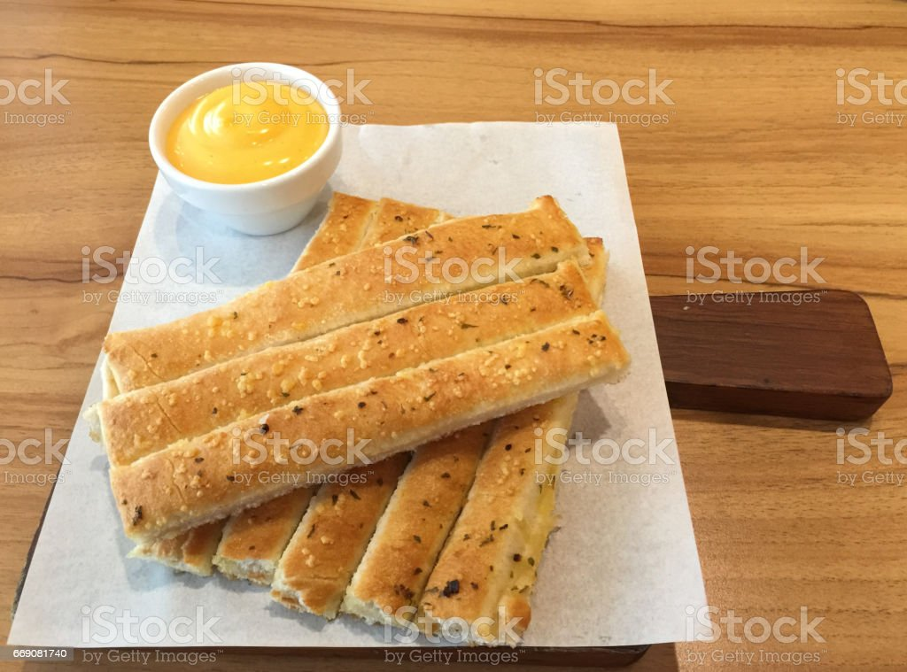 Fresh breadsticks served with dip sauce on white plate stock photo