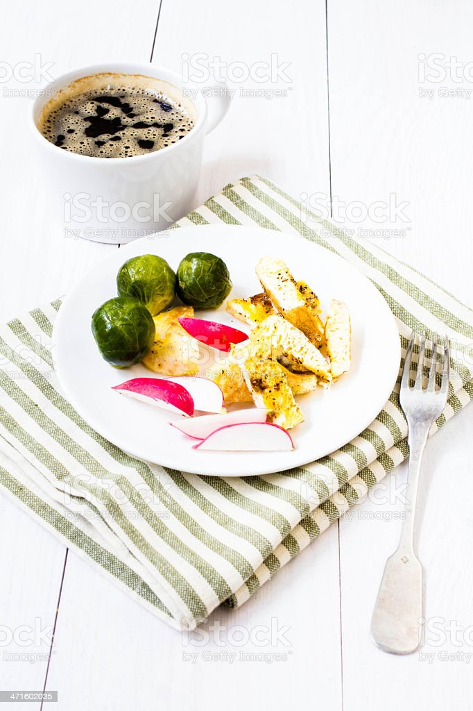 Fresh breakfast with fried eggs, brussels sprouts and radish royalty-free stock photo
