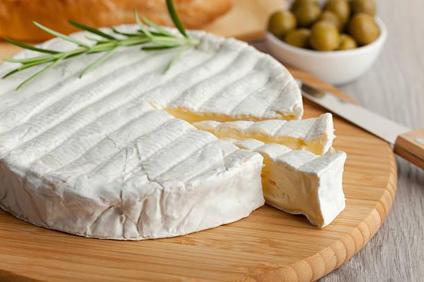 Fresh Brie cheese stock photo