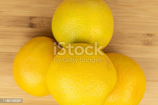 istock Fresh bright orange on light wood 1180105331