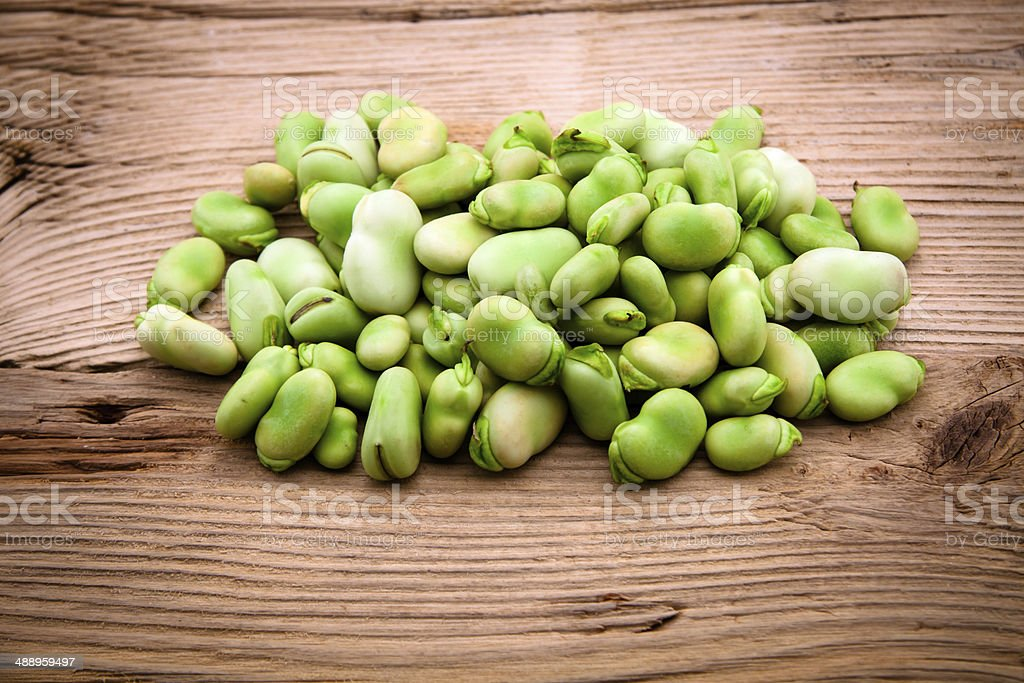 Fresh broad bean on old wooden background stock photo