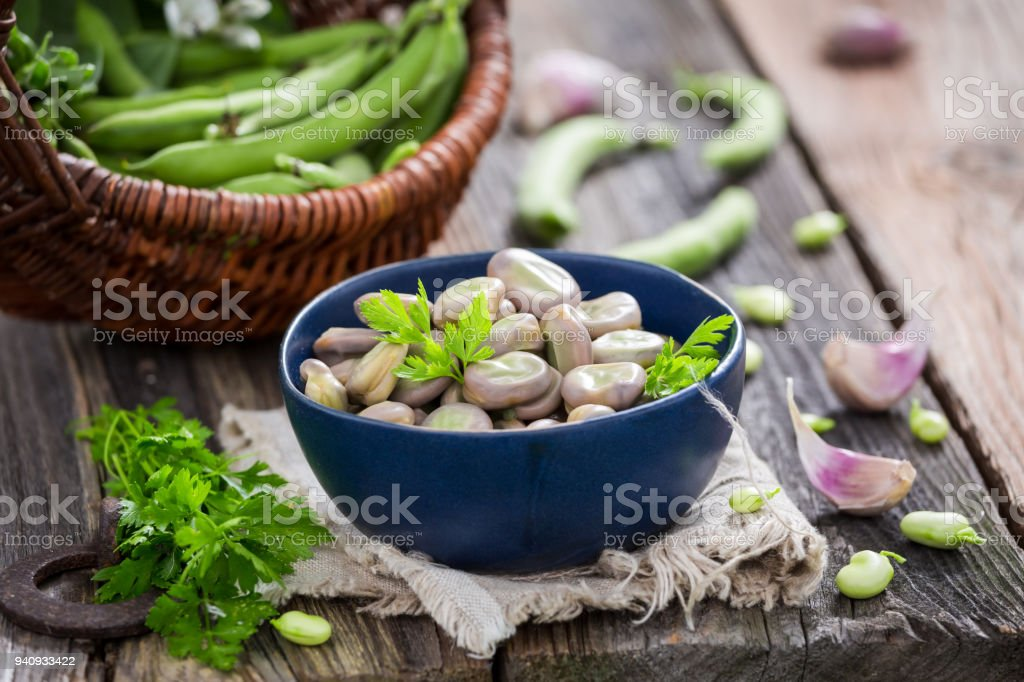 Fresh broad beans in old rustic kitchen stock photo