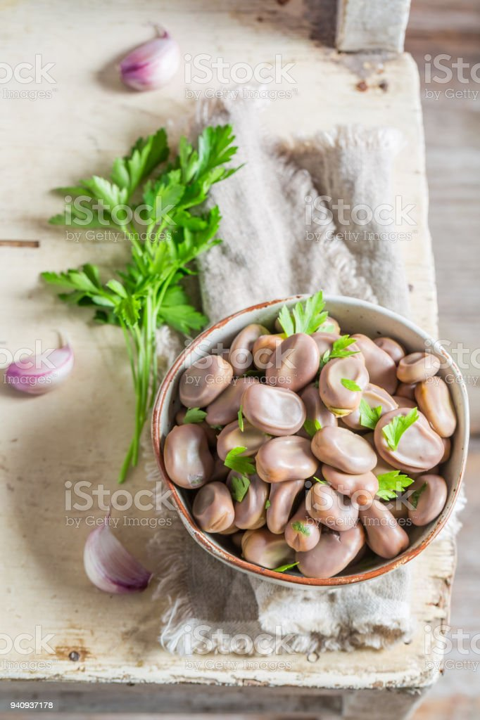 Fresh broad beans with garlic and parsley stock photo