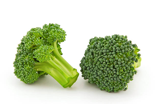 Fresh broccoli florets isolated on the white background stock photo