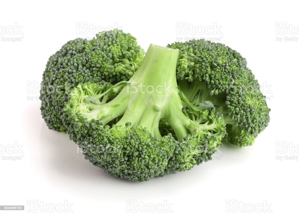 fresh broccoli isolated on white background close-up. Top view stock photo