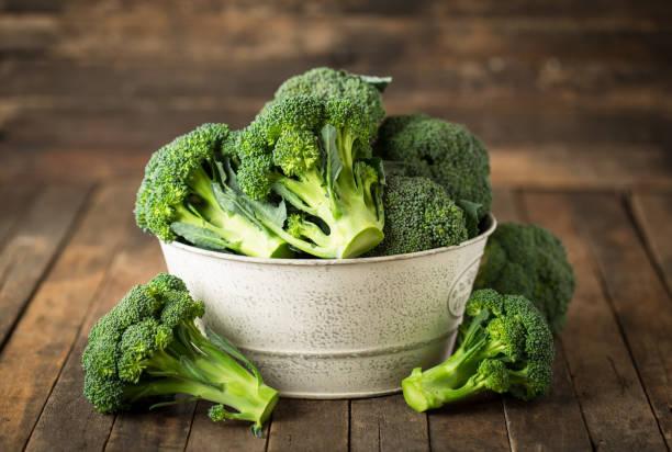 Fresh broccoli on the table stock photo