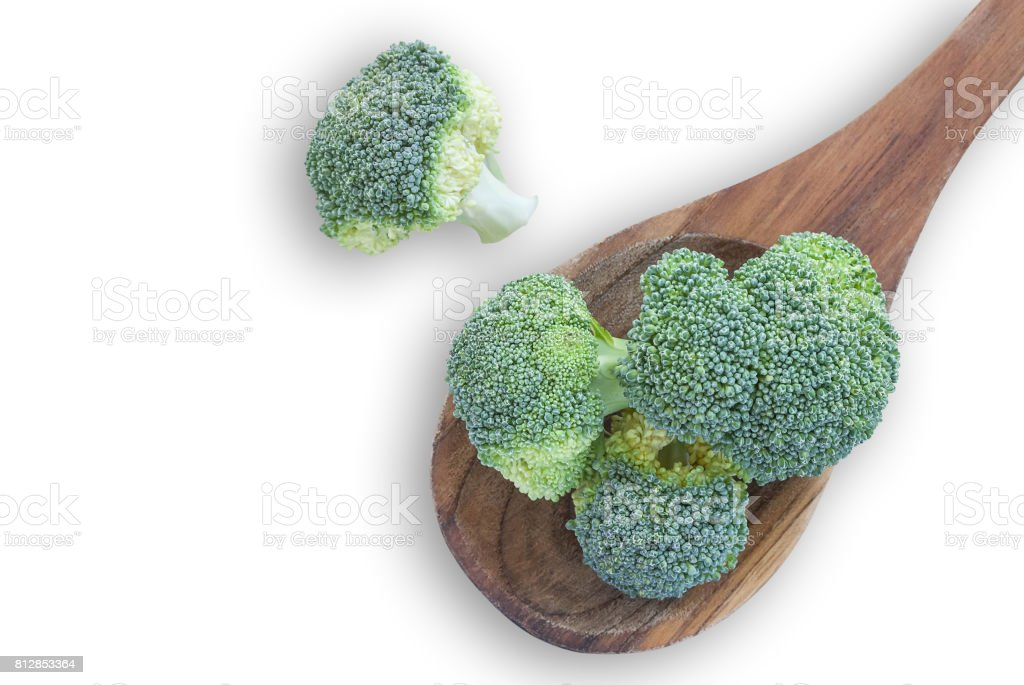 Fresh broccoli vegetable in wooden spoon isolated on white backg stock photo