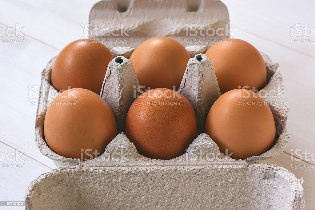 Fresh brown eggs in a carton stock photo