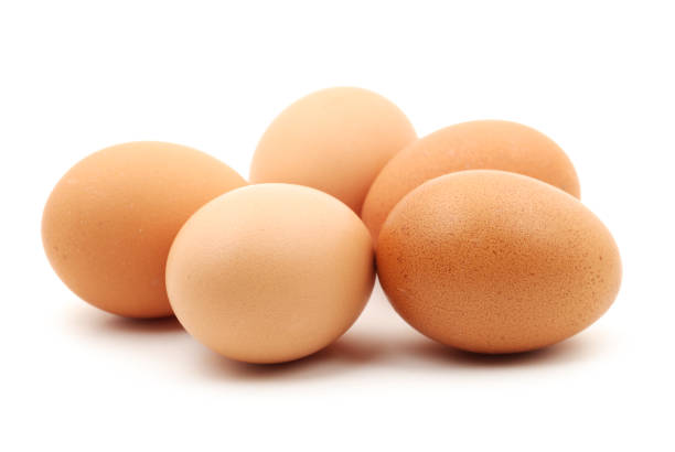 Fresh brown eggs isolate on white background stock photo