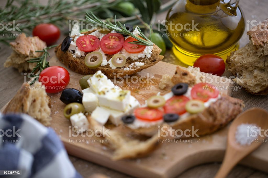 Fresh bruschetta on wooden cutting board zbiór zdjęć royalty-free