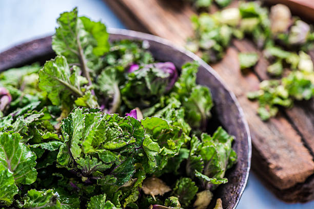 Fresh brussel and kale sprouts flower Fresh brussel and kale sprouts flower, straight from garden on table. kale stock pictures, royalty-free photos & images