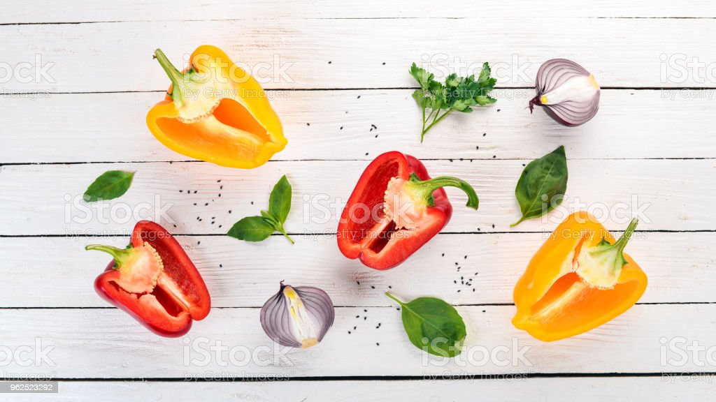 Fresh Bulgarian pepper. Paprika. On a wooden background. Top view. Copy space. - Royalty-free Bell Stock Photo
