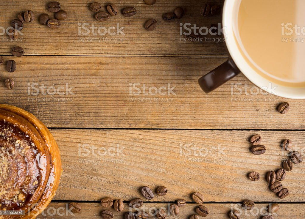 Fresh bun on the rustic wooden background stock photo