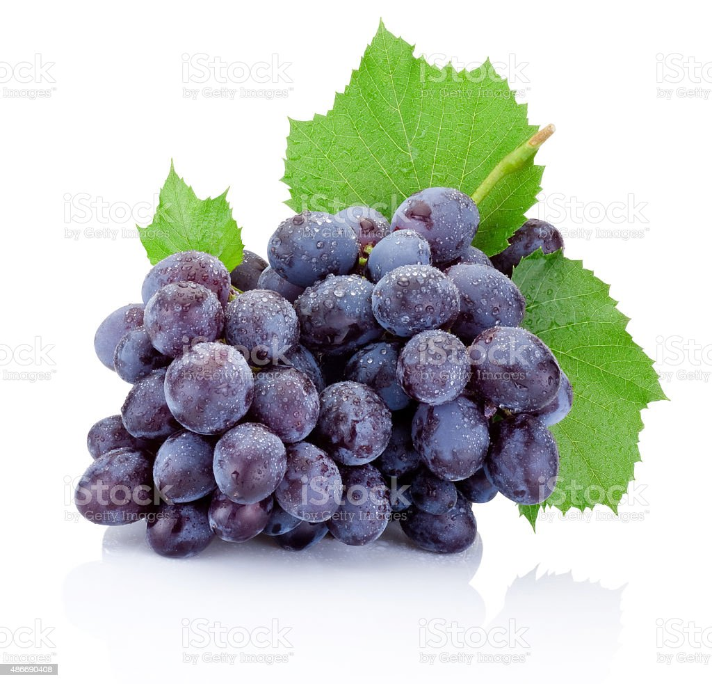 Fresh bunch of grapes with leaves isolated on white background stock photo