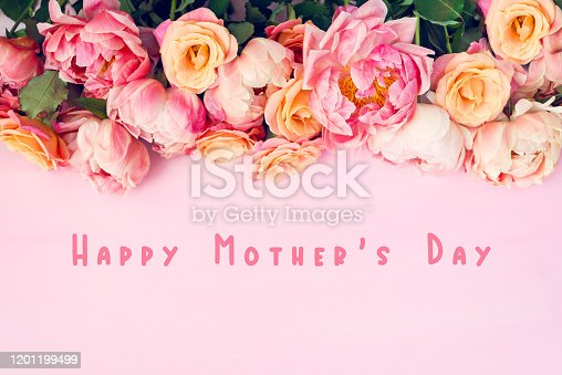 Fresh bunch of pink peonies and roses and text Happy Mothers Day. Card Concept, pastel colors, close up image