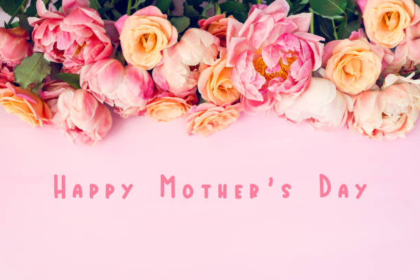 Fresh bunch of pink peonies and roses Fresh bunch of pink peonies and roses and text Happy Mothers Day. Card Concept, pastel colors, close up image mothers day stock pictures, royalty-free photos & images