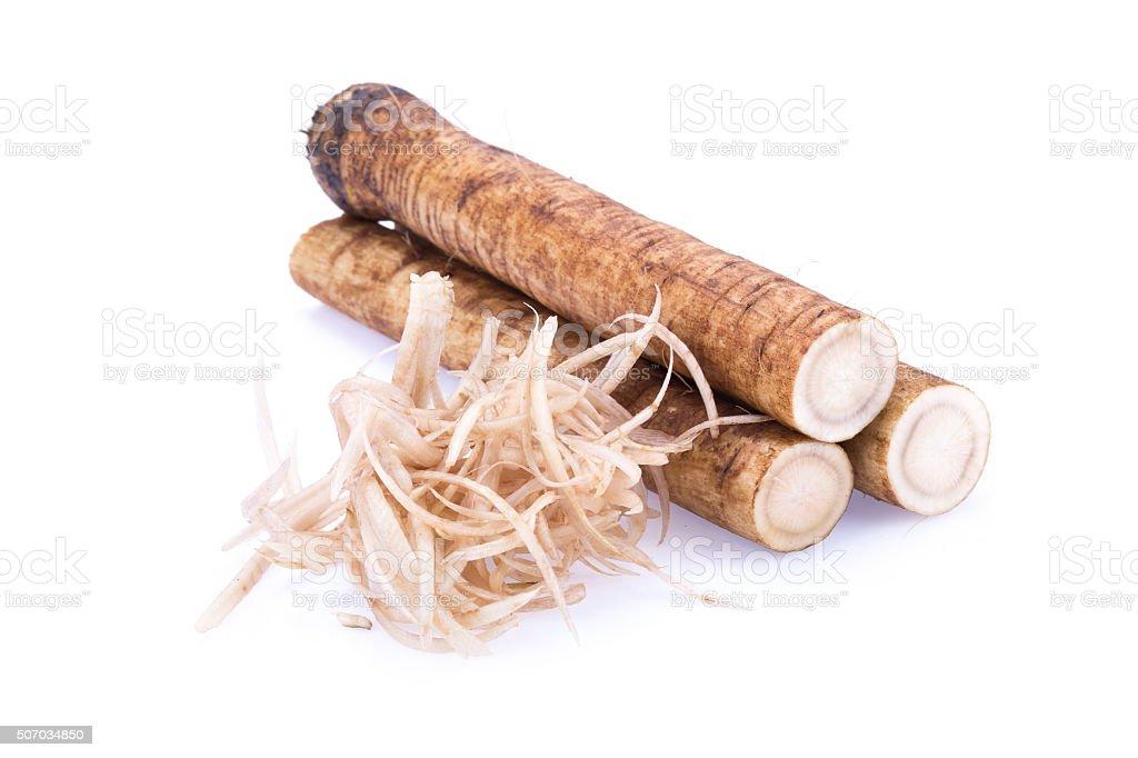 Fresh Burdock radici su sfondo bianco - foto stock