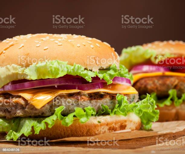 Fresh Burgers On Wooden Background Stock Photo - Download Image Now