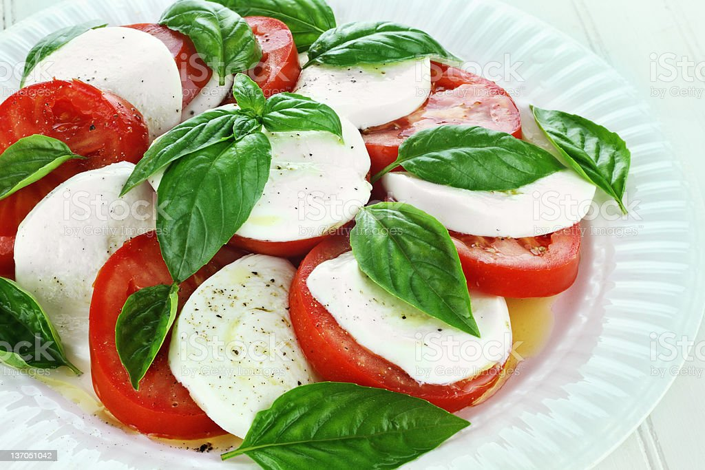 Fresh Caprese salad on a white plate stock photo