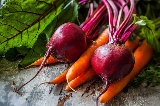 fresh carrot and beetroot Fresh organic carrots and beetroot  on old wooden board beet stock pictures, royalty-free photos & images