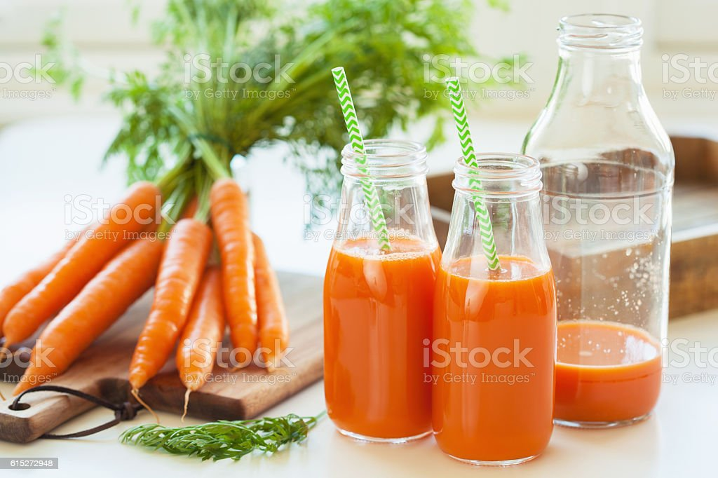 fresh carrot juice and vegetables stock photo