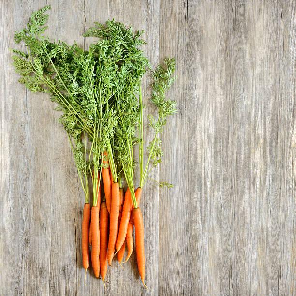 fresh carrots background stock photo