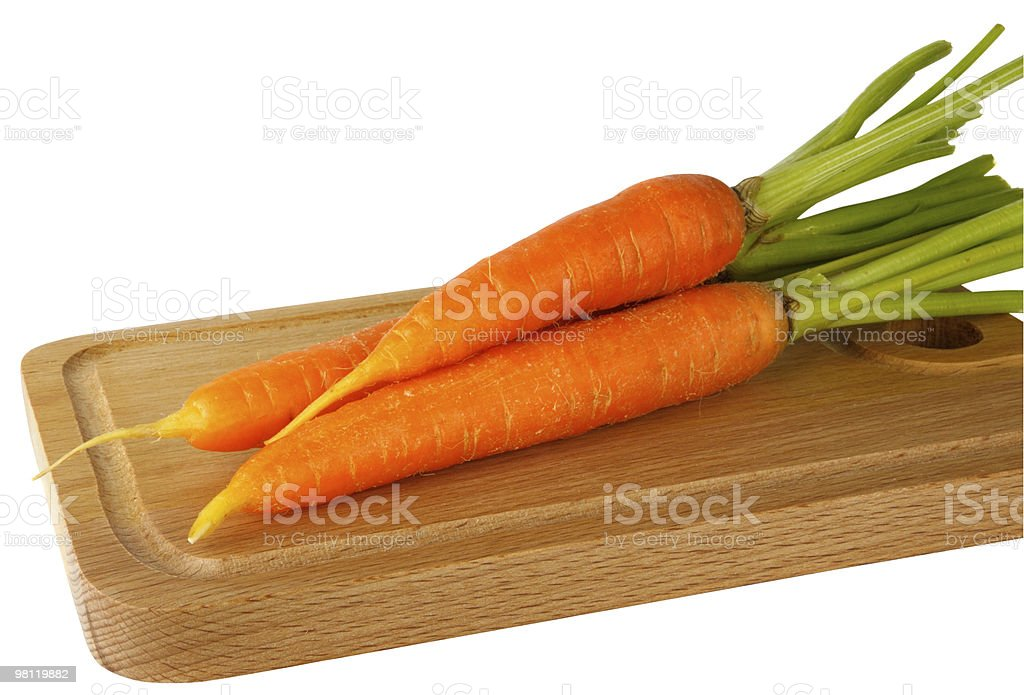 Fresh carrots on the chopping board royalty-free stock photo