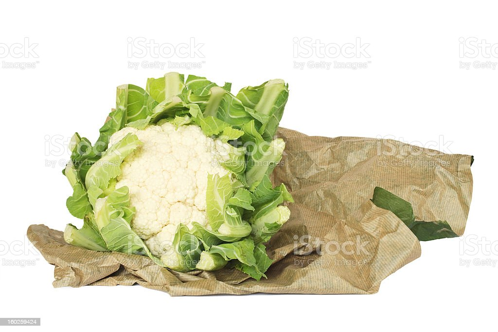 fresh cauliflower in wrapping paper, isolated on white backgroun royalty-free stock photo