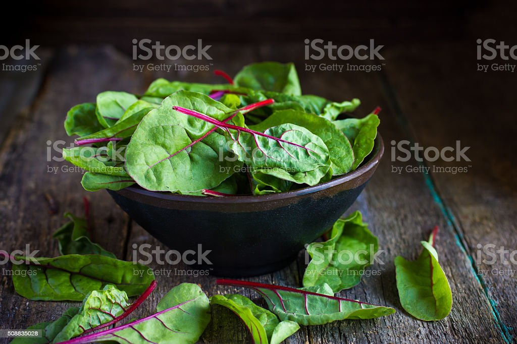 Fresh chard leaves on rustic background stock photo
