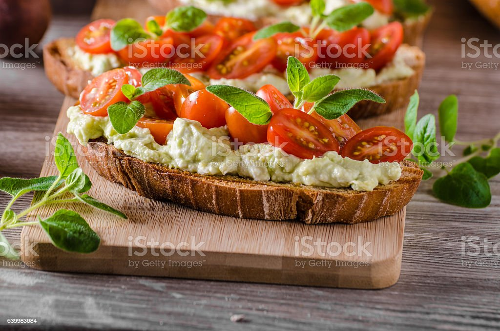 Fresh cheese panini bread with herbs stock photo