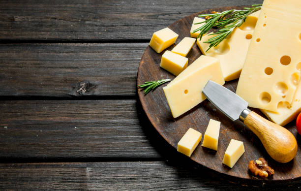 fresh cheese with rosemary on the cutting board. - cheese imagens e fotografias de stock