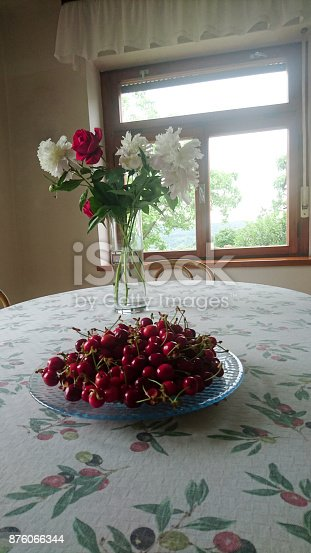 Fresh Cherries and Peonies on a Table