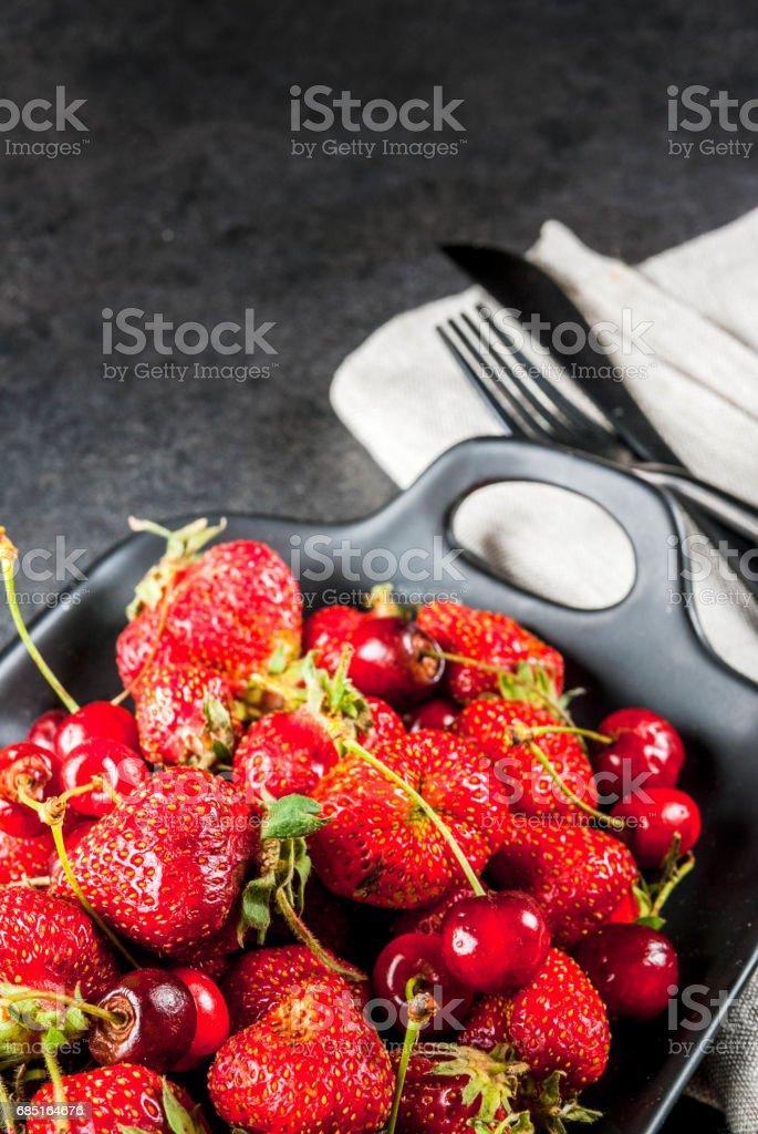 Fresh cherries and strawberries royalty-free stock photo