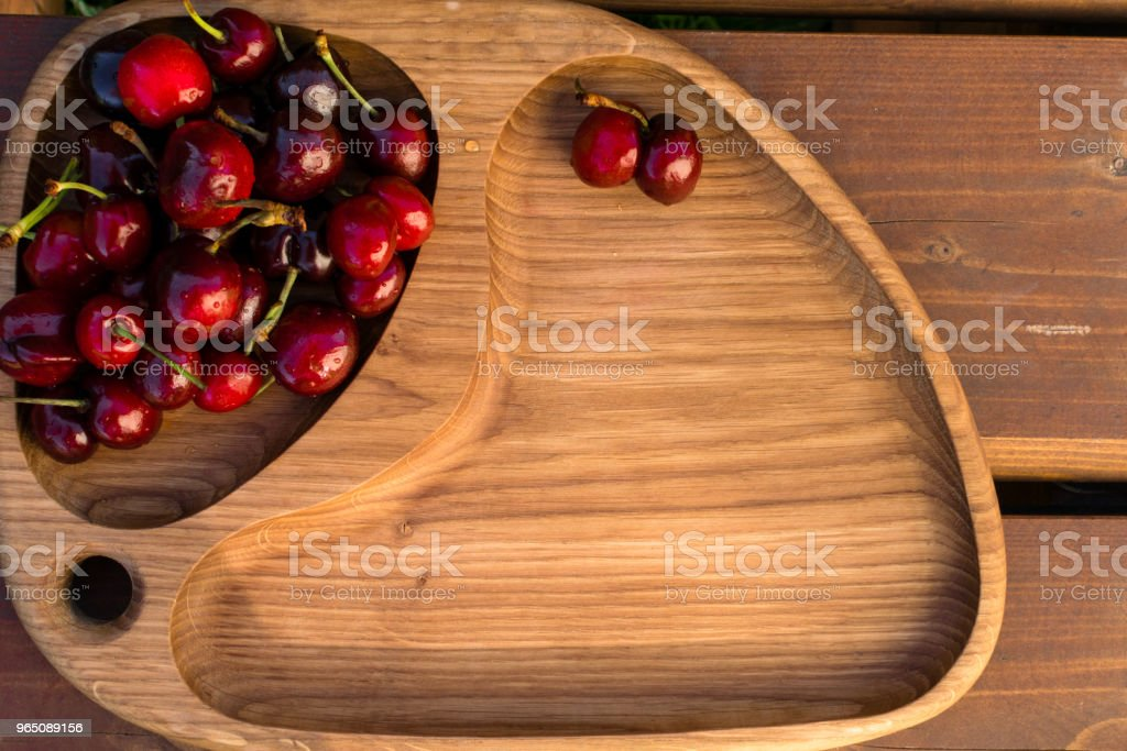Fresh cherries in the wooden board, fruits on wood table royalty-free stock photo