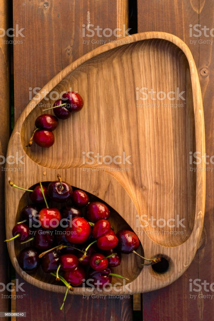 Fresh cherries in the wooden board, fruits on wood table zbiór zdjęć royalty-free