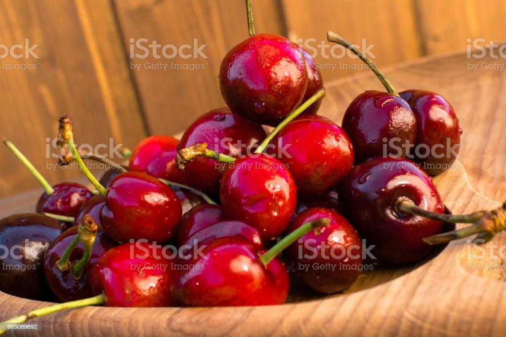 Fresh cherries in the wooden board, fruits on wood table zbiór zdjęć royalty-free
